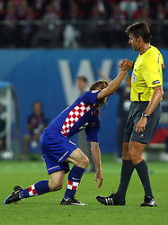 Referee Roberto Rosetti of Italy helps Luka Modric of Croatia to stand up during the UEFA EURO 2008 Quarter-Final soccer match between Croatia and Turkey at Ernst-Happel Stadium, on June 20,2008, in Wien, Austria. Turkey won after penalty shots. (Photo by Vid Ponikvar / Sportal Images)