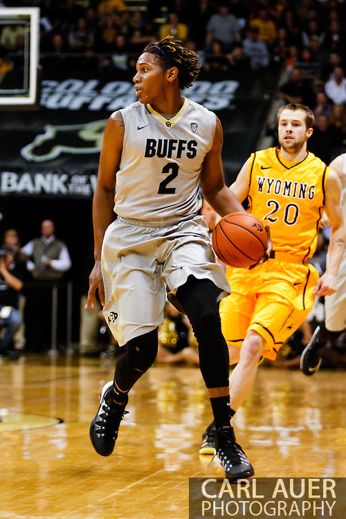 November 13th, 2013:  Colorado Buffaloes sophomore forward Xavier Johnson (2) brings the ball up the court in first half action of the NCAA Basketball game between the University of Wyoming Cowboys and the University of Colorado Buffaloes at the Coors Events Center in Boulder, Colorado