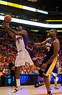 May 23, 2010; Phoenix, AZ, USA; Phoenix Suns forward Amare Stoudemire (1) puts up a shot against Los Angeles Lakers center Andrew Bynum (17) during the first quarter in game three of the western conference finals in the 2010 NBA Playoffs at US Airways Center.  Mandatory Credit: Jennifer Stewart-US PRESSWIRE