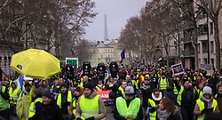 19 January 2019. Paris, France.<br /> Gilets Jaunes - Acte X take to the streets of Paris. An estimated 7,000 people took part in the looping 14 km route from Place des Invalides to protest tax hikes from the Government of Emmanuel Macron imposed on the people. An estimated 80,000 people took part in protests across the country. Regrettably the movement has attracted a violent element of agitators who often face off with riot police at the end of the marches which tends to deflect attention away from the message of the vast majority of peaceful protesters.<br /> Photo©; Charlie Varley/varleypix.com