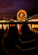 A couple enjoys the view of the South Carolina Coastal Fair in Charleston, SC.