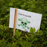 A small poster in a hedge. Reclaim the Power camp is set up in a field near Balcombe. The site is squatted but so far nor the owner nor police has made any moves to stop the camp from setting up. It is organised by the environmental group No Dash for Gas and the movement is protesting against the company Cuadrilla's fracking testing near Balcombe and have come to Balcombe to lend its support to the local protests against the drilling for gas.