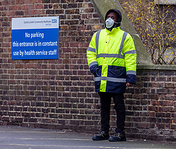 © Licensed to London News Pictures. 03/03/2020. London, UK. A security guard with a mask on stands outside a Coronavirus Drive-Thru Testing Centre at Parsons Green Health Centre Fulham, West London as Boris Johnson announces his battle plan in Downing Street for combating the coronavirus crisis. Photo credit: Alex Lentati/LNP
