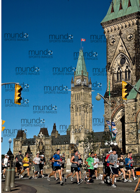"(Ottawa, Ontario -- 20 Sep 2009) Competitors in the Army Run half-marathon run past the Parliament Buildings at the start of the race in Ottawa. [Photo credit should read ""Sean Burges / Mundo Sport Images""]"