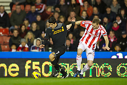 STOKE-ON-TRENT, ENGLAND - Boxing Day Wednesday, December 26, 2012: Liverpool's Luis Alberto Suarez Diaz has his shirt pulled and is fouled by Stoke City's captain Ryan Shawcross for a penalty during the Premiership match at the Britannia Stadium. (Pic by David Rawcliffe/Propaganda)