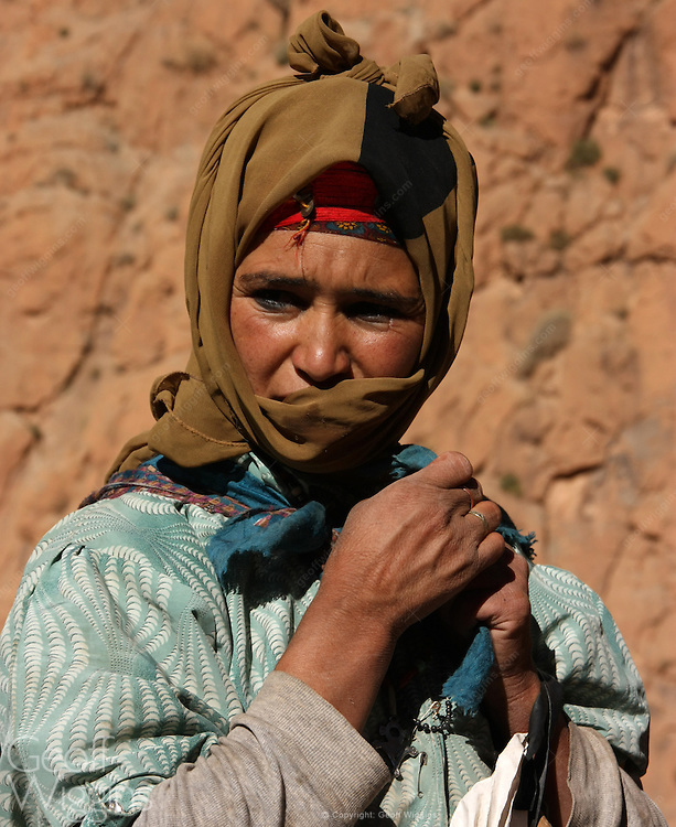 Nomad Berber woman in traditional clothing high in the Atlas Mountains Morocco