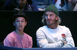 Romeo Beckham and David Beckham in the crowd during the Men's Single Final during day eight of the NITTO ATP World Tour Finals at the O2 Arena, London.