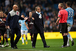 MANCHESTER, ENGLAND - Wednesday, March 24, 2010: Manchester City's manager Roberto Mancini is sent off by referee Peter Walton after clashing with Everton's manager David Moyes during the Premiership match at the City of Manchester Stadium. (Photo by David Rawcliffe/Propaganda)