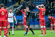 Referee Andy Madley awards a penalty late in the second half to Bolton Wanderers during the EFL Sky Bet League 1 match between Bolton Wanderers and Milton Keynes Dons at the University of  Bolton Stadium, Bolton, England on 16 November 2019.