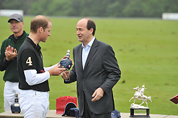Left to right, HRH The DUKE OF CAMBRIDGE and Christian Porta CEO of Chivas Brothers at the Sentebale Polo Cup held at Coworth Park, Berkshire on 12th June 2011.