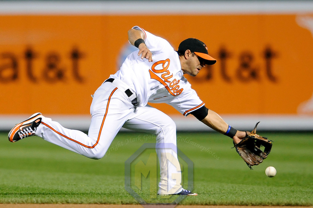 29 June 2009:  Baltimore Orioles second baseman Brian Roberts (1) cannot reach a single off the bat of Boston Red Sox right fielder J.D. Drew in the 6th inning at Camden Yards in Baltimore, MD.  The Red Sox defeated the Orioles 4-0.  ****For Editorial Use Only****