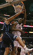 4/12/05--Los Angeles CA--Clippers Elton Brand is fouled on his way to a 4thquarter dunk by Jazz Matt Harpring.  Photo by John McCoy/Staff Photographer Los Angeles Daily News