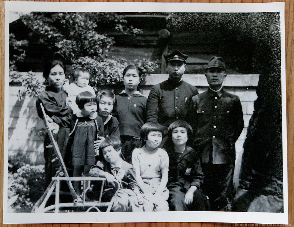 JUNKO KAYASHIGE.  Hiroshima A-Bomb survivor.  Painter. COPY: Old photo with all the family together. Picture shot before one brother went to war as a solder. Junko is the little girl at the bottom left.
