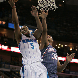 Apr 07, 2010; New Orleans, LA, USA; New Orleans Hornets guard Marcus Thornton (5) shoots over Charlotte Bobcats forward Boris Diaw (32) during the second half at the New Orleans Arena. The Bobcats defeated the Hornets 104-103. Mandatory Credit: Derick E. Hingle-US PRESSWIRE