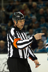 Jan 31, 2012; San Jose, CA, USA; NHL referee Mike Leggo (3) during a stoppage in play between the San Jose Sharks and the Columbus Blue Jackets during the second period at HP Pavilion. San Jose defeated Columbus 6-0. Mandatory Credit: Jason O. Watson-US PRESSWIRE