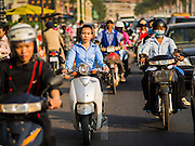 25 FEBRUARY 2015 - PHNOM PENH, CAMBODIA:  Traffic on Sisowath Quay in Phnom Penh. Sisowath Quay is the main road on the waterfront in Phnom Penh.   PHOTO BY JACK KURTZ