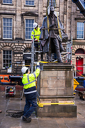 The sculpture of Sherlock Holmes by former pop-artist Gerald Laing is being moved from it's home on Picardy Place, yards from the birth place of Sir Arthur Conan Doyle.<br /> <br /> The move of the sculpture is to accommodate road and tram works that are taking place in Edinburgh. The statue will be moved to Nairn at  Black Isle Bronze Ltd by the artists son, Farquhar Laing where it will stay for two years until it returns to Edinburgh.<br /> <br /> Pictured: Final checks before the statue is lifted from its Picardy Street location