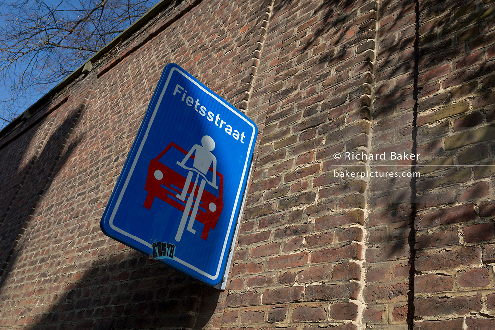A signpost in Flemish wrning motorists of shared car/cycling usage in the University city of Leuven on 24th March 2017, in Belgium.