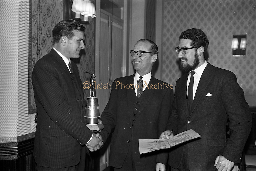 23/03/1963<br /> 03/23/1963<br /> 23 March 1963<br /> Gaelic Sports Journalists Association Presentation off Awards at the Anchor Hotel, Dublin. Picture shows John D. Hickey (centre) chairman of the Gaelic Sports Journalists Assocciation, congratulating John Doyle of Tipperary after the presentations. on the right is film director Louis Marcus.