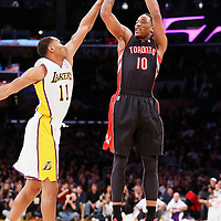 08 December 2013: Toronto Raptors shooting guard DeMar DeRozan (10) takes a jumpshot over Los Angeles Lakers shooting guard Wesley Johnson (11) during the Toronto Raptors 106-94 victory over the Los Angeles Lakers at the Staples Center, Los Angeles, California, USA.