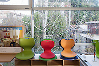 SOVERIA MANNELLI, ITALY - 16 NOVEMBER 2016: Colored seats are seen here in the showroom of Camillo Sirianni, a school furniture manifacturer in Soveria Mannelli, Italy, on November 16th 2016.<br /> <br /> Camillo Sirianni is a third generation family business that started as a family mechanized carpentry in 1909 and transformed into a leading school furniture manufacturer. In a high-tech warehouse in the outskirts of Soveria Mannelli, they assemble thousands of Calabrian beechwooden, colorful desks, benches, closets and other accessories that are later shipped to many corners of the globe, from the United Kingdom to the Emirates, from central America to Polynesia.<br /> <br /> Soveria Mannelli is a mountain-top village in the southern region of Calabria that counts 3,070 inhabitants. The town was a strategic outpost until the 1970s, when the main artery road from Naples area to Italy's south-western tip, Reggio Calabria went through the town. But once the government started building a motorway miles away, it was cut out from the fastest communications and from the most ambitious plans to develop Italy's South. Instead of despairing, residents benefited of the geographical disadvantage to keep away the mafia infiltrations, and started creating solid businesses thanks to its administrative stability, its forward-thinking mayors and a vibrant entrepreneurship numbering a national, medium-sized publishing house, a leading school furniture manufacturer and an ancient woolen mill.