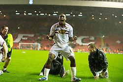 LIVERPOOL, ENGLAND - Wednesday, September 22, 2010: Northampton Town's Nathaniel Wedderburn and team-mates celebrates a famous victory over Liverpool after a penalty shoot-out during the Football League Cup 3rd Round match at Anfield. (Photo by David Rawcliffe/Propaganda)