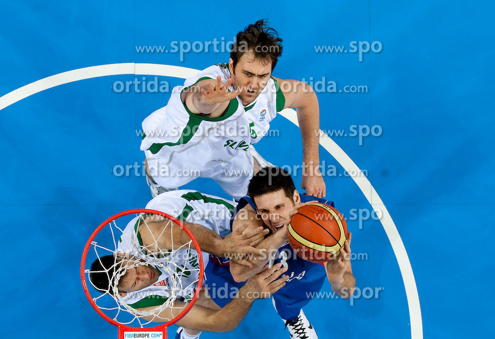 Kosta Perovic of Serbia between Goran Jagodnik of Slovenia and Erazem Lorbek of Slovenia during basketball game between National basketball teams of Slovenia and Serbia in 7th place game of FIBA Europe Eurobasket Lithuania 2011, on September 17, 2011, in Arena Zalgirio, Kaunas, Lithuania. Slovenia defeated Serbia 72 - 68 and placed 7th. (Photo by Vid Ponikvar / Sportida)