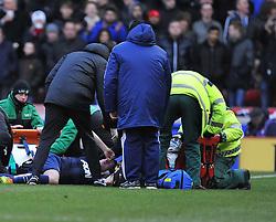 Manchester United's Phil Jones receives treatment - Photo mandatory by-line: Alex James/JMP - Tel: Mobile: 07966 386802 01/02/2014 - SPORT - FOOTBALL - Britannia Stadium - Stoke-On-Trent - Stoke v Manchester United - Barclays Premier League
