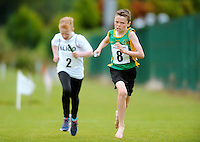 13 Aug 2016: Jack Smith, 10, from Dunshaughlin, Meath, heads for the finish line in the U12 Mixed Distance Relay heats.  2016 Community Games National Festival 2016.  Athlone Institute of Technology, Athlone, Co. Westmeath. Picture: Caroline Quinn