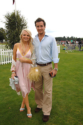 HANNAH SANDLING and OLIVER FELSTEAD at the Cartier International polo at Guards Polo Club, Windsor Great Park on 29th July 2007.<br />