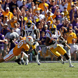 Oct 2, 2010; Baton Rouge, LA, USA; LSU Tigers cornerback Patrick Peterson (7) returns a punt during the first half against the Tennessee Volunteers at Tiger Stadium.  Mandatory Credit: Derick E. Hingle