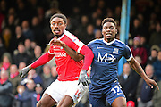 Charlton Athletic midfielder Jordan Botaka (14) and Southend United midfielder Jermaine McGlashan (17) in action during the EFL Sky Bet League 1 match between Southend United and Charlton Athletic at Roots Hall, Southend, England on 31 December 2016. Photo by Jon Bromley.