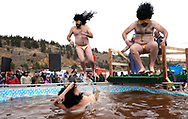 NEDERLAND, CO - MARCH 10: Three men jump into icy brown water in the Frozen Dead Guy Days Polar Plunge competition at the event on March 10, 2018 in Nederland, Colorado. The Frozen Dead Guy Days festival is in honor of Bredo Morstol, who is frozen on dry ice and housed in a shed above the town. (Photo by Rick T. Wilking/Getty Images)