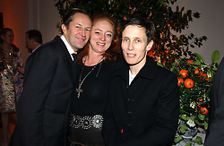 A party hosted by Mario Testino, Bianca Jagger and Kenneth Cole in collaboration with UNFPA and Marie Stopes International to celebrate the publication of Women to Woman: Positively Speaking - a book to raise awareness of women living with HIV/Aids, held at The Orangery, Kensington Palace, London on 2nd December 2004.<br />Picture shows:-Left to right, NICK ASHLEY, CAMILLA LOWTHER and SOPHIE HICKS.<br /><br />NON EXCLUSIVE - WORLD RIGHTS