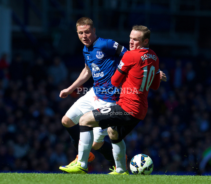 LIVERPOOL, ENGLAND - Sunday, April 26, 2015: Everton's James McCarthy in action against Manchester United's Wayne Rooney during the Premier League match at Goodison Park. (Pic by David Rawcliffe/Propaganda)
