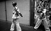 Manchester kids in Joe Bloggs flares and baggy tops skip down the street, Manchester 1988