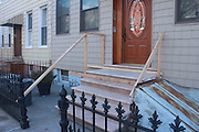 Wooden railing under construction outside a residential building in Greenpoint, Brooklyn. Photo by Philippe Theise/NYCity Photo Wire