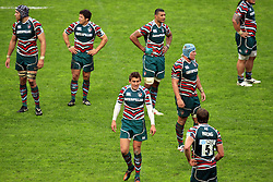 A dejected Toby Flood (c) reflects with his team mates during the Heineken Cup match between Stade Toulouse and Leicester Tigers at Stade Municipal on October 14, 2012 in Toulouse, France.  Eoin Mundow/Cleva Media