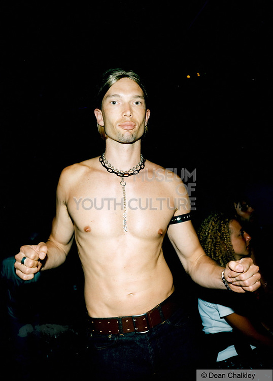 Bare chested man dancing in a club, Ibiza 1999