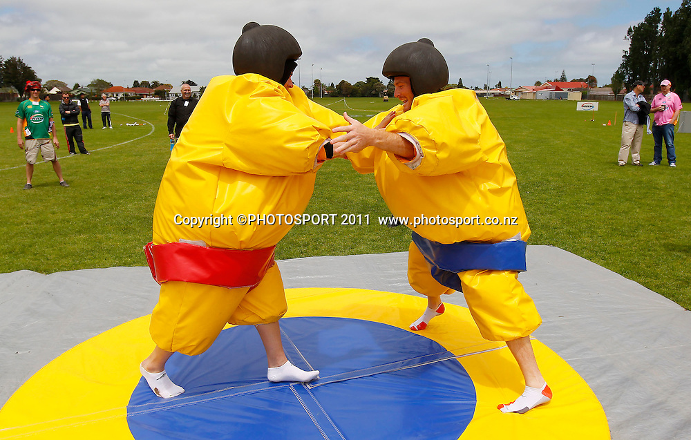 Tim Southee (L) and Martin Guptill do battle in Sumo suits during the HRV Cup Cricket Blackcaps Day, Papatoetoe Recreation Centre, Auckland, 10 November 2011. Photo: Simon Watts / photosport.co.nz