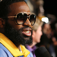 Boxer Adrien Broner is interviewed by reporters after the undercard final press conference for the Mayweather & Maidana boxing match at the Hollywood Theater, inside the MGM Grand hotel on Thursday, May 1, 2014 in Las Vegas, Nevada.  (AP Photo/Alex Menendez)