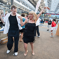LONDON, ENGLAND - JANUARY 20:  Dancers warm-up for The Big Dance 2010 Launch  at the Old Spitafields Market on January 20, 2010 in London, England. 10,000 people expected to take part in The Big Dance which will take place between July 3-11.  (Photo by Marco Secchi/Getty Images)