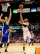 Feb. 22, 2012; Phoenix, AZ, USA; Phoenix Suns forward Grant Hill (33) puts up a shot against the Golden State Warriors center Andris Biedrins (15) and guard Monta Ellis (8) during the first half at the US Airways Center. Mandatory Credit: Jennifer Stewart-US PRESSWIRE..