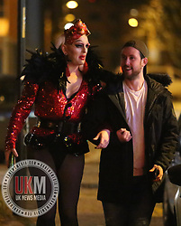 Manchester UK  24.12.2016: Images from Manchesters Gay Village during the Mad Friday celebrations this on the 23 and 24th of December,<br /> <br /> Two friends walk down the street