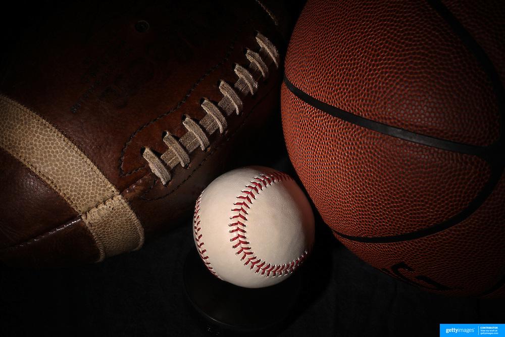 A studio shot of an American Football, a baseball, and a basketball. 17th October 2012. Photo Tim Clayton