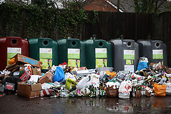 Empty bottles dumped in front of glass recycling bins at a centre near Bracknell, Berkshire.