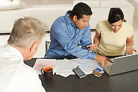 Accountant Working with Couple