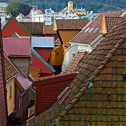 Bryggen (Norwegian for the Wharf), also known as Tyskebryggen (the German Wharf) is a series of Hanseatic commercial buildings lining the eastern side of the fjord coming into Bergen, Norway. Bryggen has since 1979 been on the UNESCO list for World Cultural Heritage sites. Seen from the back, here, the jumbled rooftops don't say much for town planning in the middle ages!