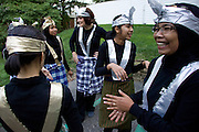 """Memebers of the Ohio University PERMIAS student organization joke with each other after earlier performing a traditional Indonesian Saman Dance at the ?Integrating Islam in the Social Studies Curriculum,"""" Sponsored by The National Resource Centers for African and Southeast Asian Studies and the Ohio Valley International Council."""