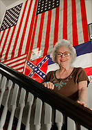 Curator Lois Swaney-Shipp stands on the staircase in the Marshall County Historical Museum Oct. 10, 2011 in Holly Springs, Miss. The museum features an off-beat collection of more than 100,000 Mississippi oddities and curiosities as well as a wealth of local history. (Photo by Carmen K. Sisson/Cloudybright)